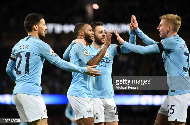 Raheem Sterling of Manchester City celebrates with teammates Bernardo Silva David Silva and Oleksandr Zinchenko after scoring his team's sixth goal...