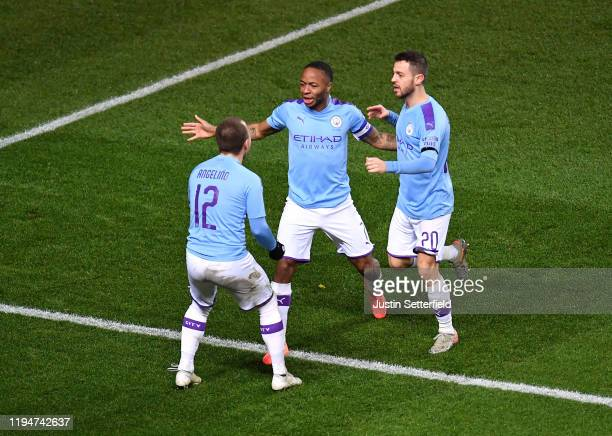 Raheem Sterling of Manchester City celebrates with teammates Bernardo Silva and Angelino after scoring his team's second goal during the Carabao Cup...