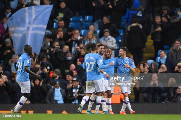 Raheem Sterling of Manchester City celebrates with teammates his teams third goal which is later disallowed by VAR during the Premier League match...