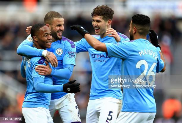 Raheem Sterling of Manchester City celebrates with teammates Riyad Mahrez Kyle Walker and John Stones after scoring his team's first goal during the...