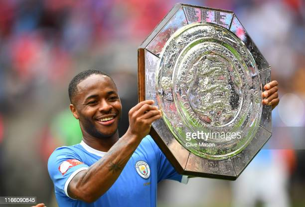 Raheem Sterling of Manchester City celebrates with the FA Community Shield following his team's victory in the FA Community Shield match at Wembley...