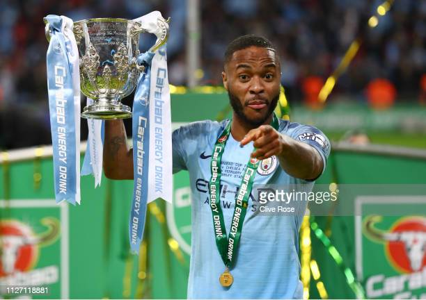 Raheem Sterling of Manchester City celebrates with the trophy after winning the Carabao Cup Final between Chelsea and Manchester City at Wembley...