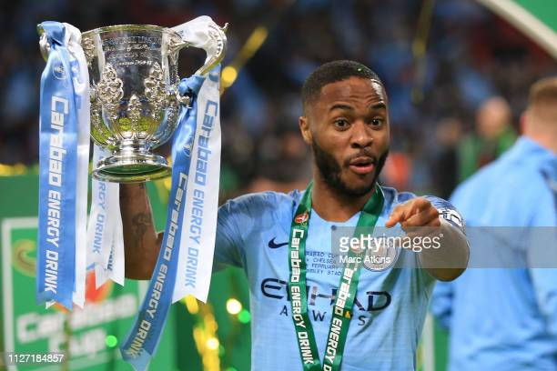Raheem Sterling of Manchester City celebrates with the trophy during the Carabao Cup Final between Chelsea and Manchester City at Wembley Stadium on...