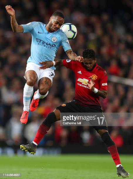 Raheem Sterling of Manchester City competes for a header with Fred of Manchester United during the Premier League match between Manchester United and...