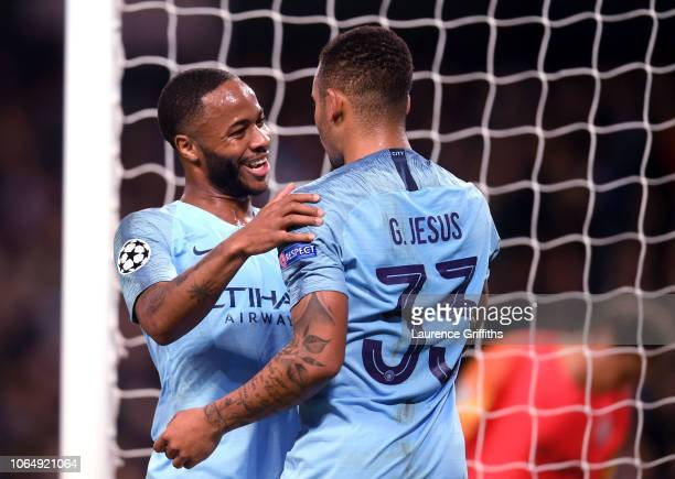 Raheem Sterling of Manchester City congratulates Gabriel Jesus on scoring his second goal during the Group F match of the UEFA Champions League...