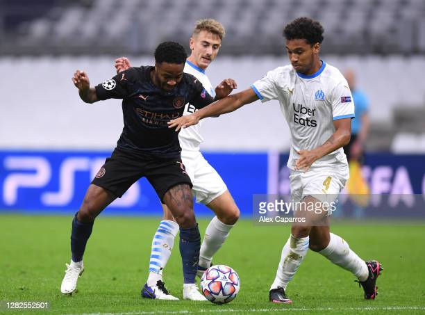 Raheem Sterling of Manchester City controls the ball as Valentin Rongier of Marseille and Boubacar Kamara of Marseille look on during the UEFA...