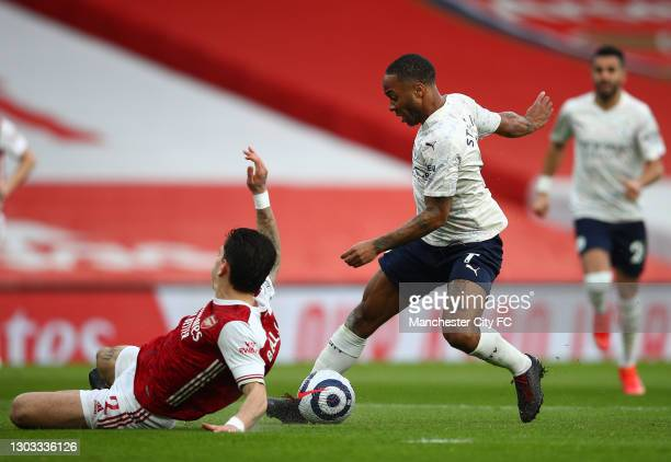 Raheem Sterling of Manchester City controls the ball under pressure from Hector Bellerin of Arsenal during the Premier League match between Arsenal...