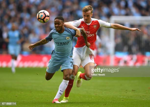 Raheem Sterling of Manchester City controls the ball under pressure of Rob Holding of Arsenal during the Emirates FA Cup SemiFinal match between...