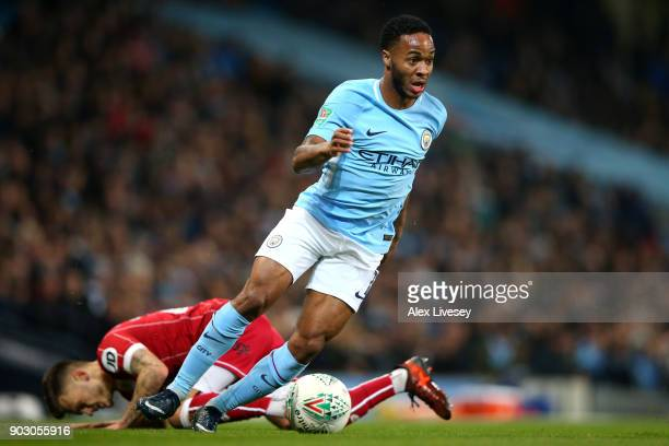 Raheem Sterling of Manchester City evades Jamie Paterson of Bristol City during the Carabao Cup SemiFinal First Leg match between Manchester City and...