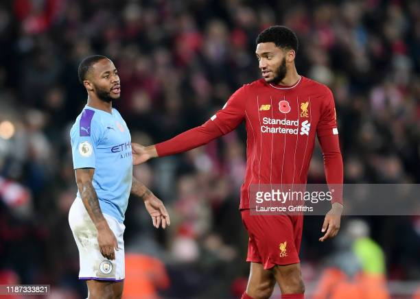 Raheem Sterling of Manchester City exchanges words with Joe Gomez of Liverpool following during the Premier League match between Liverpool FC and...