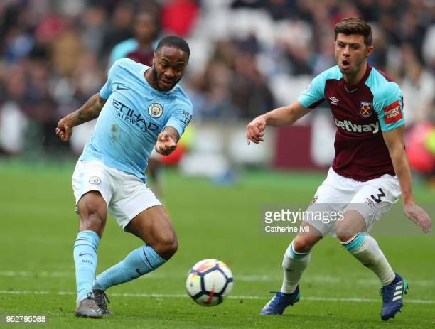 Raheem Sterling of Manchester City gets past Aaron Cresswell of West Ham United during the Premier League match between West Ham United and...