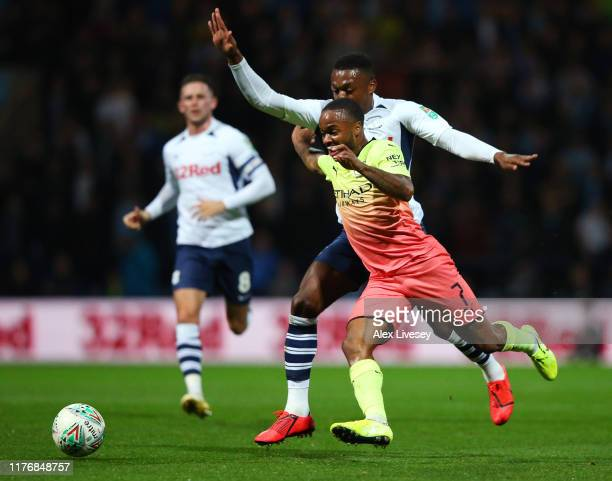 Raheem Sterling of Manchester City gets past Darnell Fisher of Preston North End to go on and score his team's first goal during the Carabao Cup...