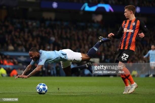 Raheem Sterling of Manchester City goes down in the box winning a penalty during the Group F match of the UEFA Champions League between Manchester...