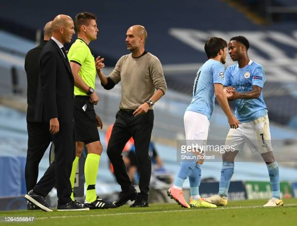Raheem Sterling of Manchester City greets David Silva of Manchester City as Raheem Sterling is substituted off and David Silva is substituted on...