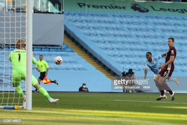 Raheem Sterling of Manchester City has an effort saved by Kasper Schmeichel of Leicester City during the Premier League match between Manchester City...