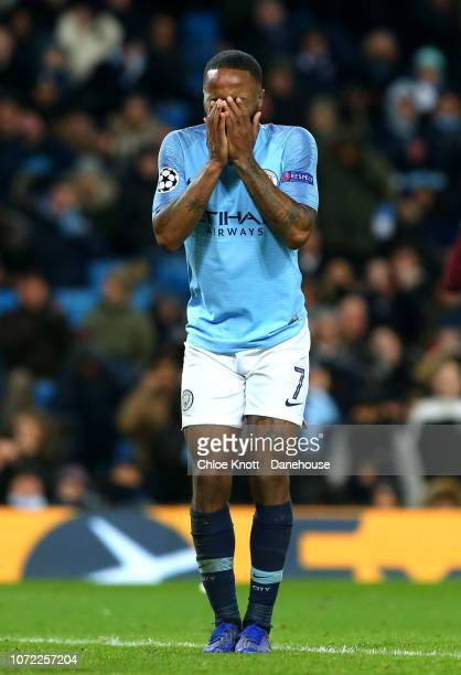 Raheem Sterling of Manchester City holds his head in his hands after missing a shot at goal during the UEFA Champions League Group F match between...