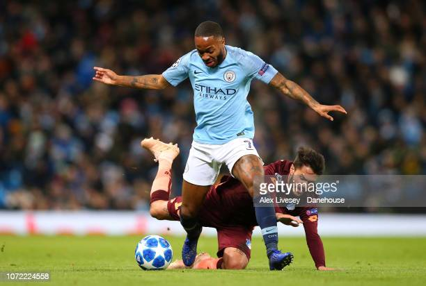 Raheem Sterling of Manchester City holds off a challenge from Leonardo Bittencourt of TSG 1899 Hoffenheim during the UEFA Champions League Group F...