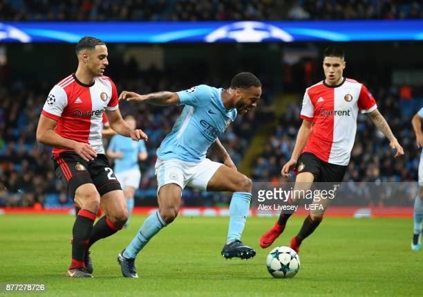 Raheem Sterling of Manchester City holds off a challenge from Sofyan Amrabat of Feyenoord during the UEFA Champions League group F match between...