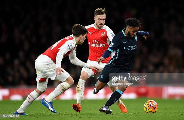 Raheem Sterling of Manchester City holds off Hector Bellerin of Arsenal and Aaron Ramsey of Arsenal during the Barclays Premier League match between...