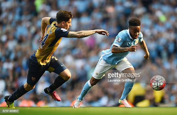 Raheem Sterling of Manchester City holds off Hector Bellerin of Arsenal during the Barclays Premier League match between Manchester City and Arsenal...