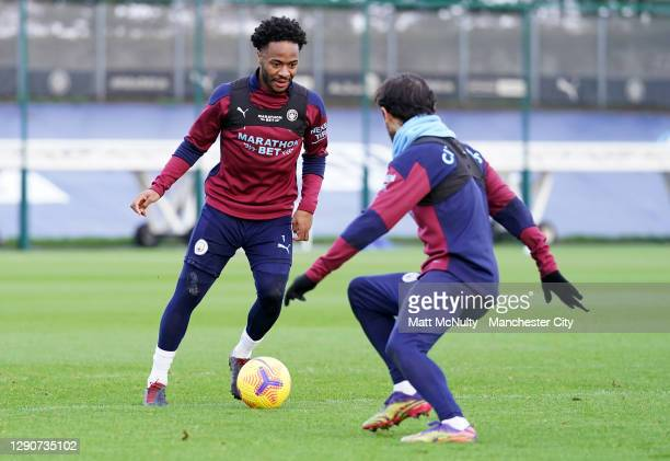Raheem Sterling of Manchester City in action during a training session at Manchester City Football Academy on December 11, 2020 in Manchester,...