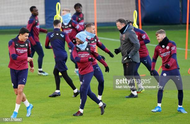 Raheem Sterling of Manchester City in action during a training session at Manchester City Football Academy on February 09, 2021 in Manchester,...