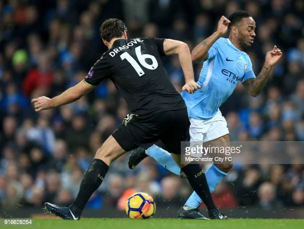 Raheem Sterling of Manchester City is challenged by Aleksander Dragovic of Leicester City during the Premier League match between Manchester City and...