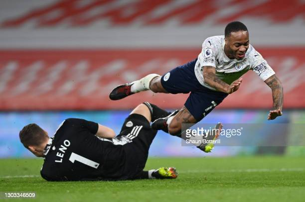 Raheem Sterling of Manchester City is challenged by Bernd Leno of Arsenal during the Premier League match between Arsenal and Manchester City at...