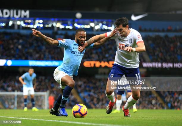 Raheem Sterling of Manchester City is challenged by Charlie Daniels of AFC Bournemouth during the Premier League match between Manchester City and...