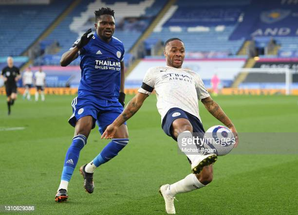 Raheem Sterling of Manchester City is challenged by Daniel Amartey of Leicester City during the Premier League match between Leicester City and...