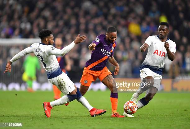 Raheem Sterling of Manchester City is challenged by Danny Rose of Tottenham Hotspur and Victor Wanyama of Tottenham Hotspur during the UEFA Champions...