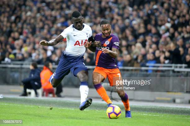 Raheem Sterling of Manchester City is challenged by Davinson Sanchez of Tottenham Hotspur during the Premier League match between Tottenham Hotspur...