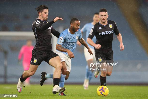 Raheem Sterling of Manchester City is challenged by Jack Grealish of Aston Villa during the Premier League match between Manchester City and Aston...