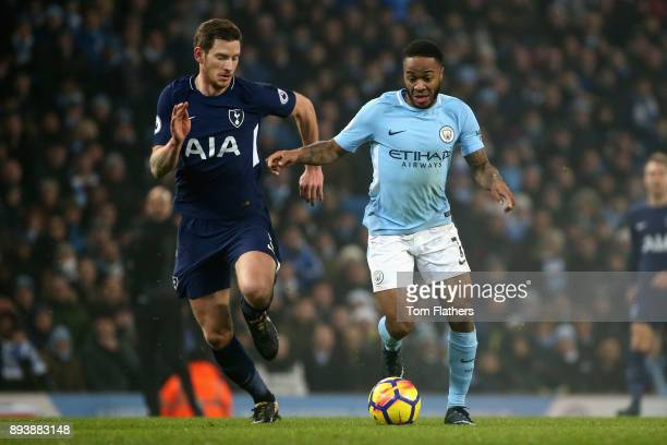 Raheem Sterling of Manchester City is challenged by Jan Vertonghen of Tottenham Hotspur during the Premier League match between Manchester City and...