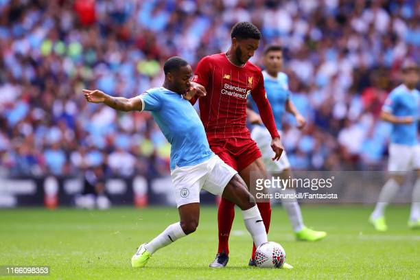 Raheem Sterling of Manchester City is challenged by Joe Gomez of Liverpool during the FA Community Shield match between Liverpool and Manchester City...