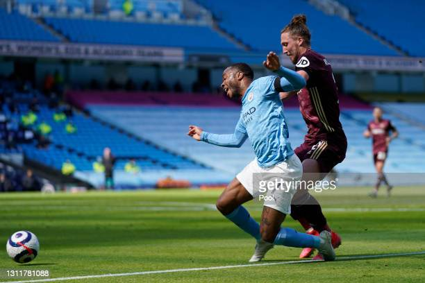 Raheem Sterling of Manchester City is challenged by Luke Ayling of Leeds United during the Premier League match between Manchester City and Leeds...