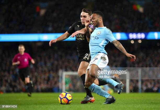 Raheem Sterling of Manchester City is challenged by Matty James of Leicester City during the Premier League match between Manchester City and...