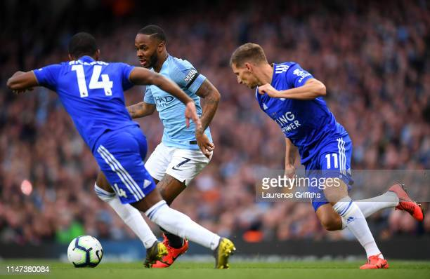Raheem Sterling of Manchester City is challenged by Ricardo Pereira of Leicester City and Marc Albrighton of Leicester City during the Premier League...