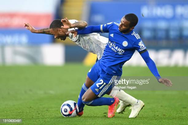 Raheem Sterling of Manchester City is challenged by Ricardo Pereira of Leicester City during the Premier League match between Leicester City and...