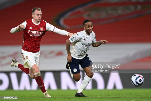 Raheem Sterling of Manchester City is challenged by Rob Holding of Arsenal during the Premier League match between Arsenal and Manchester City at...