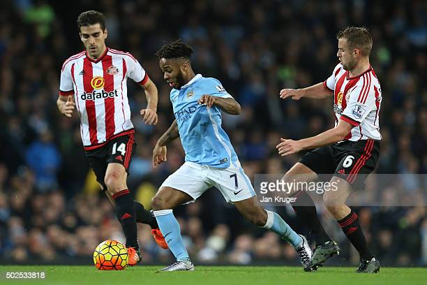 Raheem Sterling of Manchester City is closed down by Jordi Gomez of Sunderland and Lee Cattermole of Sunderland during the Barclays Premier League...
