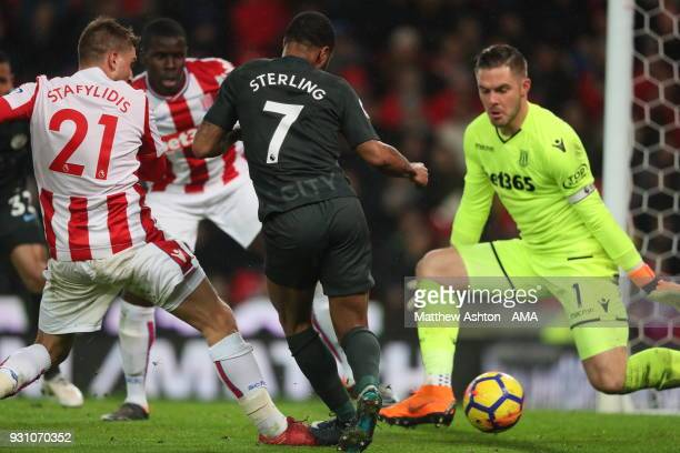 Raheem Sterling of Manchester City is denied by Jack Butland of Stoke City during the Premier League match between Stoke City and Manchester City at...