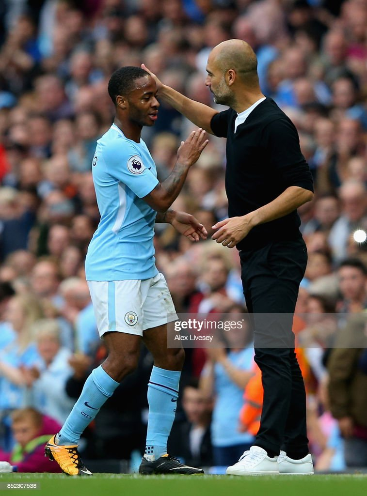 Raheem Sterling of Manchester City is embraced by manager Josep Guardiola after substituted during the Premier League match between Manchester City and Crystal Palace at Etihad Stadium on September 23, 2017 in Manchester, England.