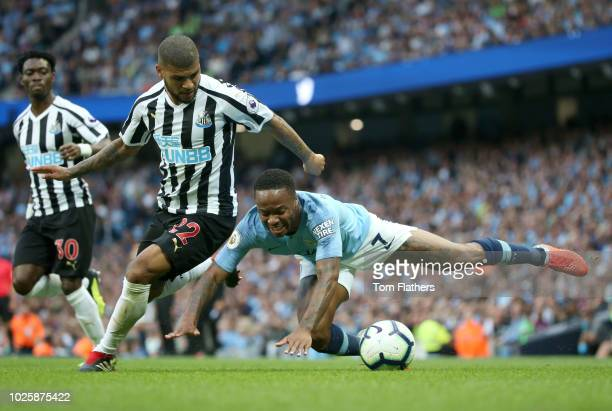 Raheem Sterling of Manchester City is fouled by Deandre Yedlin of Newcastle United during the Premier League match between Manchester City and...