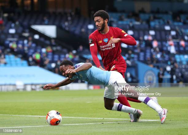 Raheem Sterling of Manchester City is fouled by Joe Gomez of Liverpool and a penalty is awarded during the Premier League match between Manchester...