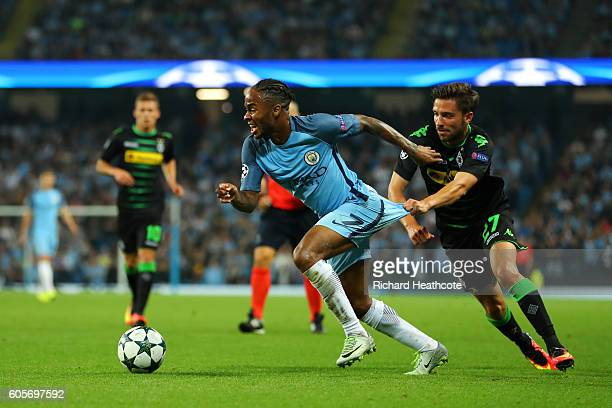 Raheem Sterling of Manchester City is pulled back by Julian Korb of Borussia Moenchengladbach during the UEFA Champions League match between...