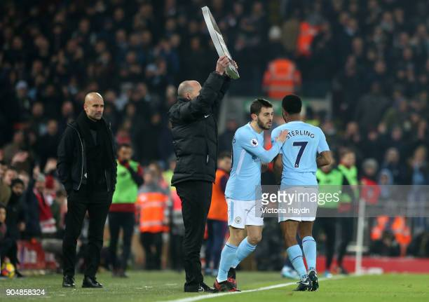 Raheem Sterling of Manchester City is substituted for Bernardo Silva of Manchester City during the Premier League match between Liverpool and...