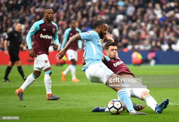 Raheem Sterling of Manchester City is tackled by Aaron Cresswell of West Ham United during the Premier League match between West Ham United and...