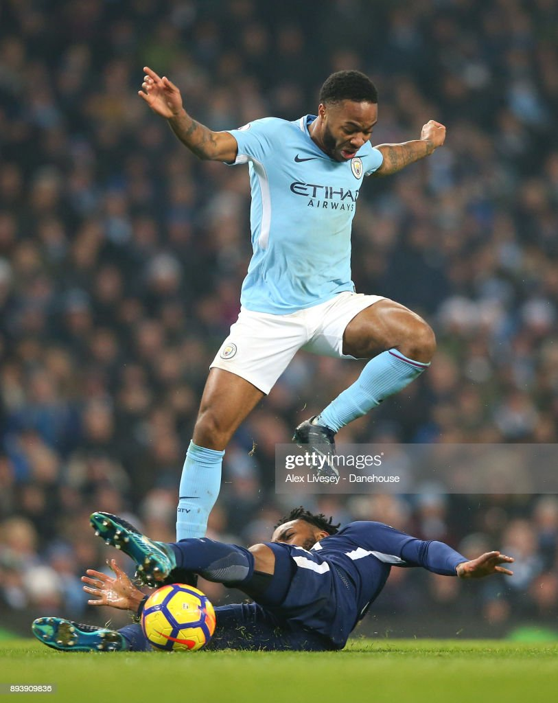 Raheem Sterling of Manchester City is tackled by Danny Rose of Tottenham Hotspur during the Premier League match between Manchester City and Tottenham Hotspur at Etihad Stadium on December 16, 2017 in Manchester, England.