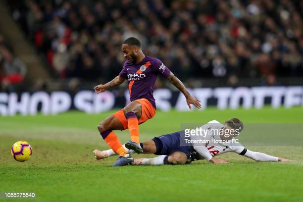 Raheem Sterling of Manchester City is tackled by Harry Winks of Tottenham Hotspur during the Premier League match between Tottenham Hotspur and...